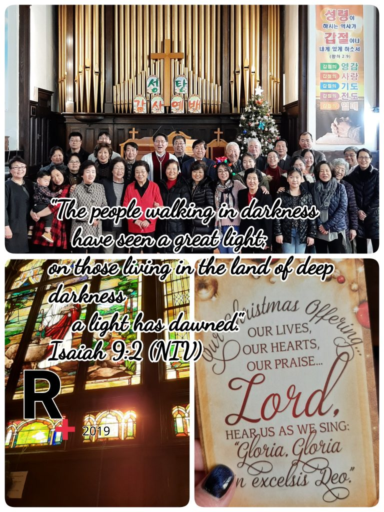 "Alternate text: Three separate pictures are combined in a collage. Topmost picture is of the church. Bottom left is of a mosaic window of Christ as shepherd. Bottom right is a picture of the offering envelope with the words, ""Our Christmas Offering Our lives, our hearts, our praise. Lord, hear us as we sing, ""Gloria, Gloria, in excelsis Deo."" In the middle of the picture, is a quote from ISaiah 9:2 NLT). On the Bottom left of the text is the Redemption Ministries logo, a bold black R with red small cross on its bottom right corner. The photo is simply dated 2019."